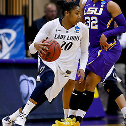 Mar 26, 2013; Baton Rouge, LA, USA; Penn State Lady Lions guard Alex Bentley (20) drives past LSU Tigers guard Danielle Ballard (32) in the first half during the second round of the 2013 NCAA womens basketball tournament at Pete Maravich Assembly Center. Mandatory Credit: Derick E. Hingle-USA TODAY Sports