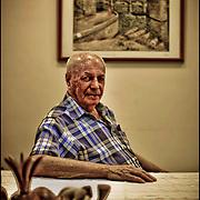 PORTRAITS OF SURVIVORS AND IMMIGRANTS <br /> Sobreviviente del Holocausto / Holocaust Survivor.<br /> <br /> Sr. Leil Ekerman.<br /> <br /> Nació el 12 de agostó de 1937 en Novosselitsa, Rumania. Al llegar los alemanes debió esconderse en una caja de madera y poco después fue confinado con parte de la familia en unas caballerizas en las que permanecieron en condiciones difíciles hasta el final de la guerra. Llegó a Venezuela en 1947.<br /> <br /> Photography by Aaron Sosa<br /> Caracas - Venezuela 2010<br /> (Copyright © Aaron Sosa)