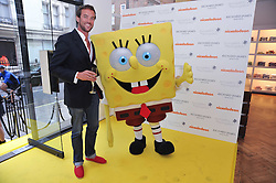 CHARLIE BORRADAILE and SpongeBob SquarePants arriving at a party to launch a range of SpongeBob SquarePants suits and accessories designed by Richard James in partnership with Nickelodeon held at Richard James, 29 Savile Row, London W1 on 11th May 2011.