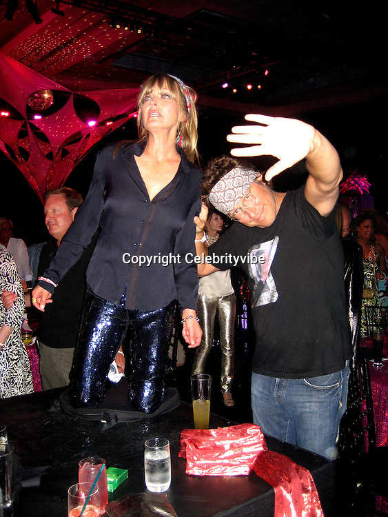 **EXCLUSIVE**.Bo Derek & John Corbett.Silly 70's Party with performances by Aerosmith, Earth Wind, Fire & Village People & Stevie Wonder.Opening of Cain at The Cove Hotel.Grand Ballroom.Atlantis Hotel.Paradise Island, Bahamas.Saturday, May 12, 2007 .Photo By Celebrityvibe.To license this image please call (212) 410 5354; or.Email: celebrityvibe@gmail.com ;.