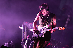© Licensed to London News Pictures. 06/09/2014. Isle of Wight, UK. Foals performing live at Bestival 2014 Day 3 Saturday. In this picture Jimmy Smith.  Foals are an English indie rock band from consisting of members Yannis Philippakis (lead vocals, lead guitar,drums), Jack Bevan (drums), Jimmy Smith (rhythm guitar), Walter Gervers (bass), Edwin Congreave (keyboards).  This weekend's headliners include Chic featuring Nile Rodgers, Foals and Outcast.   Bestival is a four-day music festival held at the Robin Hill country park on the Isle of Wight, England. It has been held annually in late summer since 2004.    Photo credit : Richard Isaac/LNP