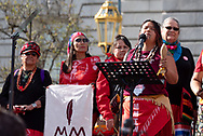 San Francisco, USA. 19th January, 2019. The Women's March San Francisco begins with a rally at Civic Center Plaza in front of City Hall. Missing and murdered indigenous women was a prominent theme at the march and rally. A group of Native American women dressed in red gathered as the rally began and also marched to bring attention to the issue in Northern California. Here, the arist, author and activist Kanyon Sayers-Roods opens the rally with a song. Sayers-Roods is of Costanoan Ohlone and Chumash heritage, and her work has been featured at the De Young Museum and The Somarts Gallery. Credit: Shelly Rivoli/Alamy Live News