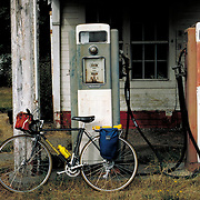 """No Gas"" - Loaded touring bicycle at abandoned gas station. Bike-tography by Martha Retallick."