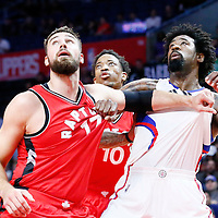 5 October 2016: Los Angeles Clippers center DeAndre Jordan (6) vies for the rebound with Toronto Raptors center Jonas Valanciunas (17) and Toronto Raptors guard DeMar DeRozan (10) during the Los Angeles Clippers 104-98 victory over the Toronto Raptors, at the Staples Center, Los Angeles, California, USA.