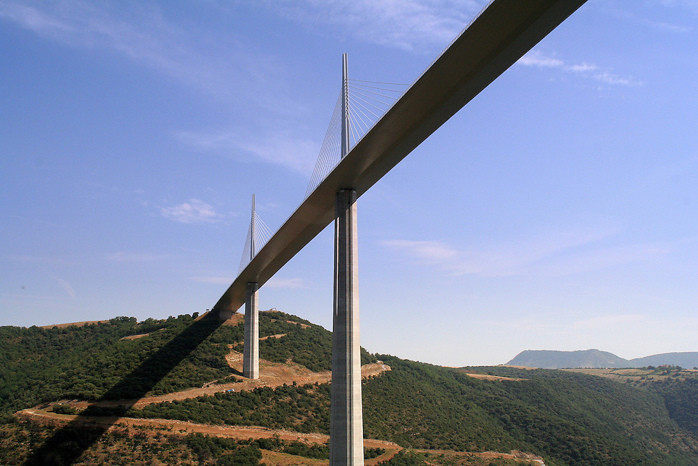 The Millau Viaduct (Le Viaduc de Millau) is a cable-stayed road-bridge that spans the valley of the river Tarn near Millau in southern France. Designed by the French structural engineer Michel Virlogeux and British architect Norman Foster, it is the tallest bridge in the world, with one mast's summit at 343.0 metres (1,125 ft). It is the 12th highest bridge in the world, at 270 metres (890 ft)[1] high below the road deck.[2] The viaduct is part of the A75-A71 autoroute axis from Paris to Montpellier