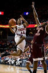 Virginia guard Sean Singletary (44) shoots over Virginia Tech forward Jeff Allen (0).  The Virginia Cavaliers men's basketball team faced the Virginia Tech Hokies at the John Paul Jones Arena in Charlottesville, VA on January 16, 2008.