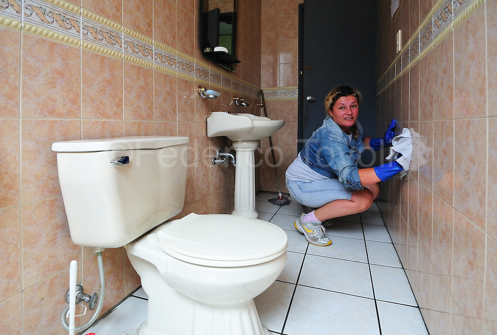 Leidy was left the violence of her land. She's employed to clean some bureau in Quito, including toilets