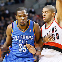 04 December 2013: Portland Trail Blazers power forward LaMarcus Aldridge (12) defends on Oklahoma City Thunder small forward Kevin Durant (35) during the Portland Trail Blazers 111-104 victory over the Oklahoma City Thunder at the Moda Center, Portland, Oregon, USA.