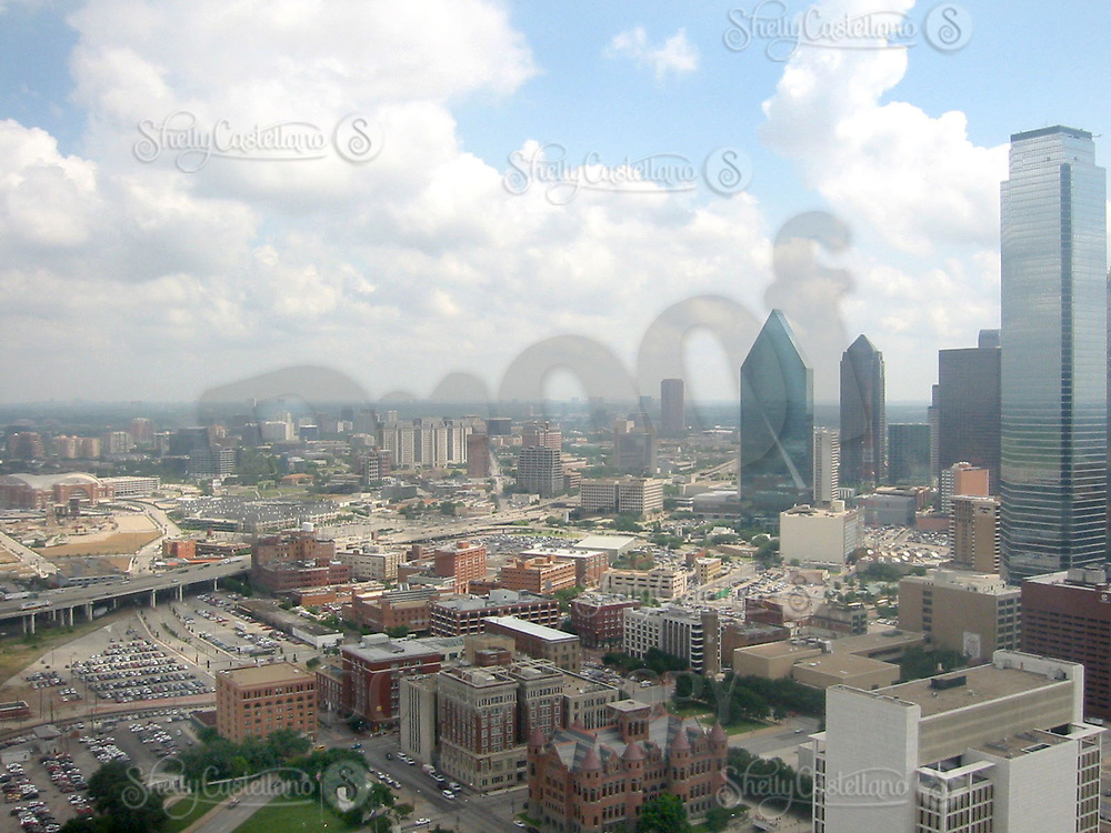 Jun 21, 2002; Dallas, TX, USA; Downtown Dallas on a partially cloudy day. American Airlines Arena in the background (far left) the Texas Book Depository and Dealey Plaza (foreground) with skyscrapers on right.  Mandatory Credit: Photo by Shelly Castellano/ZUMA Press. (©) Copyright 2002 by Shelly Castellano