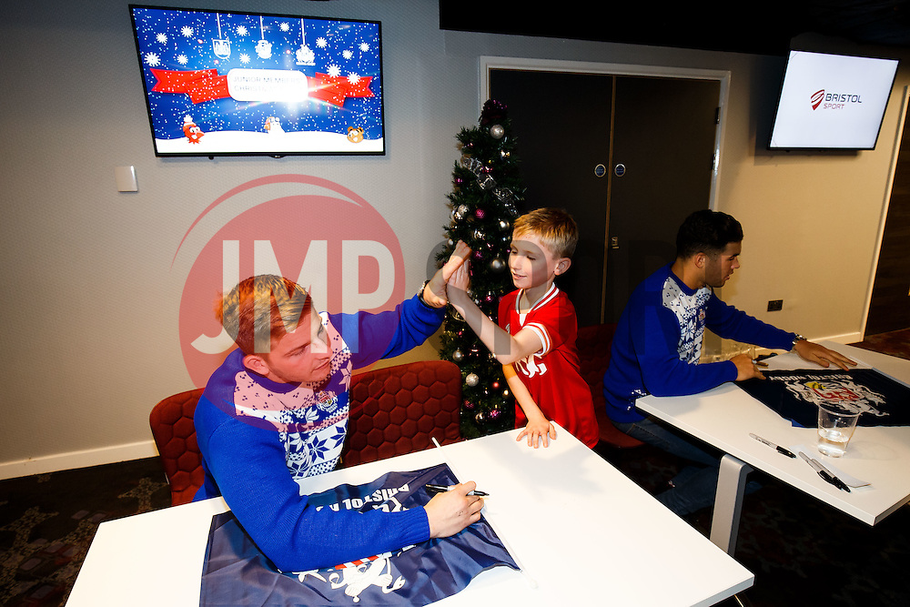 Auguy Slowik of Bristol Rugby signs autographs as Season ticket holders and members of Bristol Sport 7s and Forever Bristol take part in a Bristol Sport Christmas Party - Mandatory byline: Rogan Thomson/JMP - 22/12/2015 - SPORT - Ashton Gate Stadium - Bristol, England - Bristol Sport Christmas at Ashton Gate.