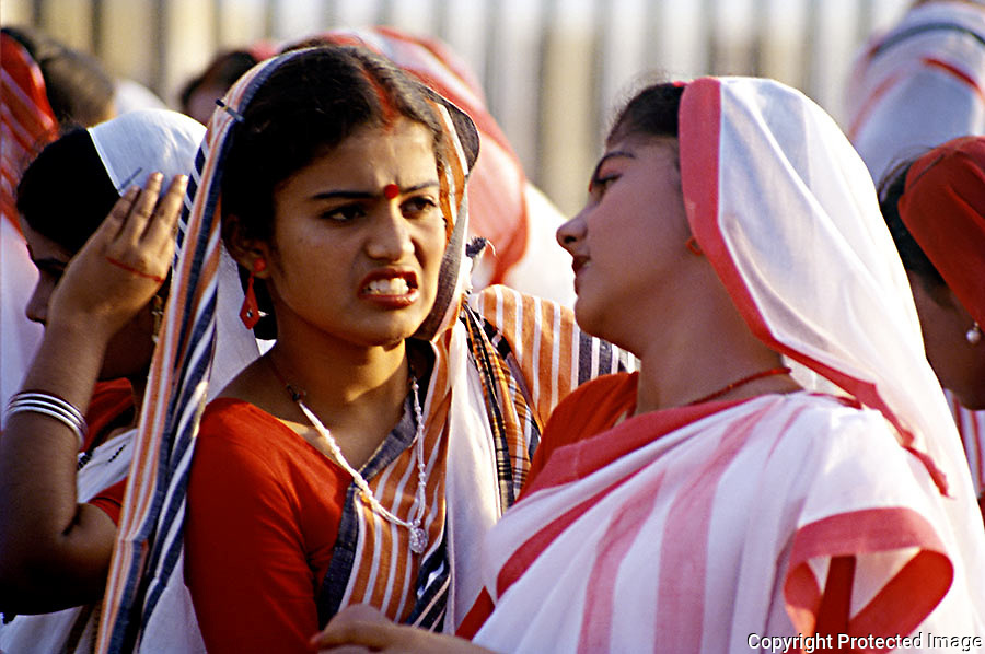 Candid shot of school girls in arguiment during the Republic day celebrations on the Marina,Chennai,India.