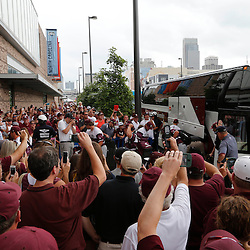 Jun 25, 2013; Omaha, NE, USA; Mississippi State Bulldogs players and coaches walk off the team bus as fans take photos before game 2 of the College World Series finals against the UCLA Bruins at TD Ameritrade Park. Mandatory Credit: Derick E. Hingle-USA TODAY Sports