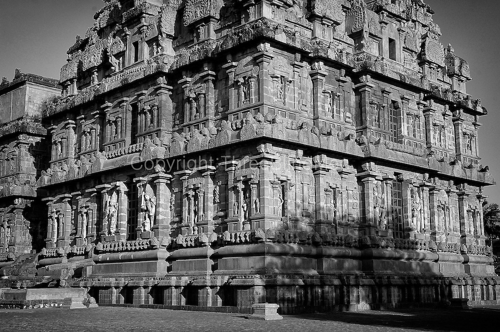 """The Brihadishwara Temple  also known as Rajarajeswaram, at Thanjavur, is the world's first complete granite temple and a brilliant example of the major heights achieved by Cholas in temple architecture. It is a tribute and a reflection of the power of its patron RajaRaja Chola I. It remains as one of the greatest glories of Indian architecture. The temple is part of the UNESCO World Heritage Site """"Great Living Chola Temples"""" and this temple is an ultimate testimonial for the vishwakarmas architectural cognizence in planning and sculpting this temple..This temple is one of India's most prized architectural sites. The temple stands amidst fortified walls that were probably added in the 16th century. The 'Vimana' - or the temple tower - is 216†ft (66†m) high [4] (about 70 meters) and is among the tallest of its kind in the world. The Kalash or 'Shikhara' (apex or the bulbous structure on the top) of the temple is of monolithic granite weighing 81.25 tons. There is a big statue of Nandi (sacred bull), carved out of a single rock, at the entrance measuring about 16 feet long and 13 feet high. The entire temple structure is made out of hard granite stones, a material sparsely available currently in Thanjavur area where the temple is located."""