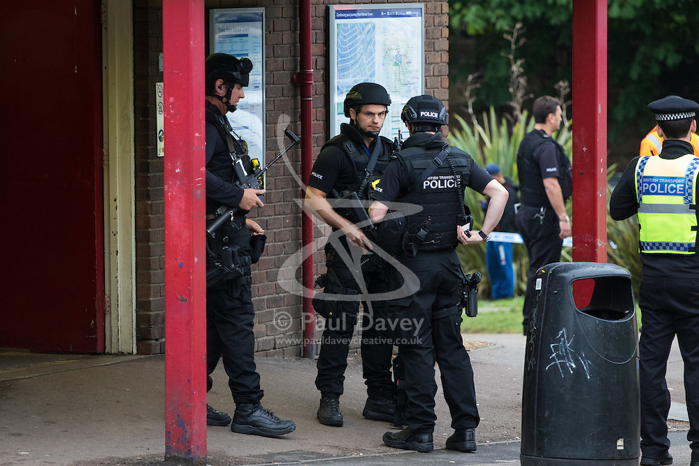 """Kensal Green, London, May 31st 2016. Police in body armoured protective headgear seal off Kensal Green tube station in North West London in what is described as a """"security incident"""". PICTURED: Armed officers outside the station entrance."""