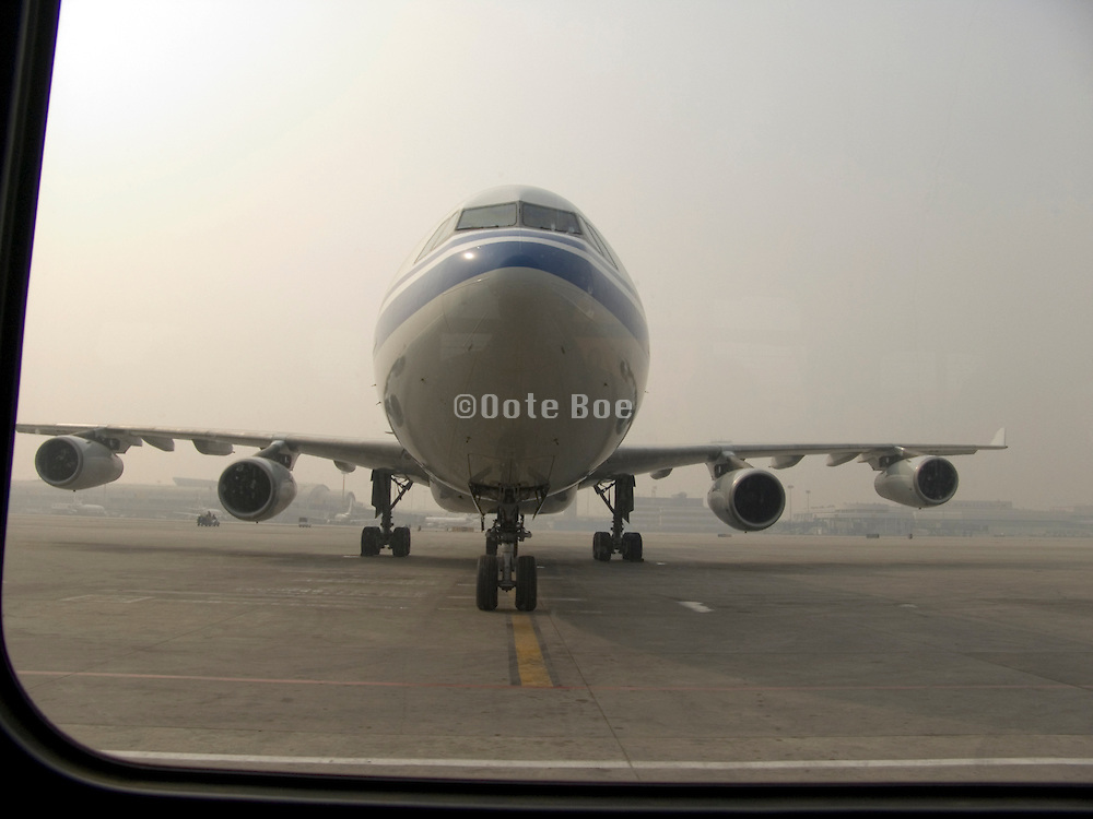a commercial passenger airplane parked on the tarmac