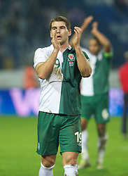 OSIJEK, CROATIA - Tuesday, October 16, 2012: Wales' Sam Vokes applauds the travelling supporters after his side's 2-0 defeat by Croatia during the Brazil 2014 FIFA World Cup Qualifying Group A match at the Stadion Gradski Vrt. (Pic by David Rawcliffe/Propaganda)