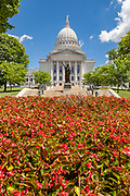 The Wisconsin State House Building and statue Forward on Capital Square in Madison, Wisconsin. Construction of the present capitol, the third in Madison, began in late 1906 and was completed in 1917 at a cost of $7.25 million.