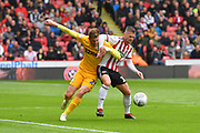 Preston North End forward Tom Barkhuizen (29)  and Sheffield United midfielder Oliver Norwood (16) during the EFL Sky Bet Championship match between Sheffield United and Preston North End at Bramall Lane, Sheffield, England on 22 September 2018. Picture. Ian Lyall