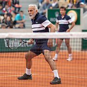 PARIS, FRANCE June 05. Mansour Bahrami of France playing with Fabrice Santoro of France in action against Sergi Bruguera of Spain and Goran Ivanisevic of Croatia on Court Simonne-Mathieu during the Men's Legends over 45 competition at the 2019 French Open Tennis Tournament at Roland Garros on June 5th 2019 in Paris, France. (Photo by Tim Clayton/Corbis via Getty Images)
