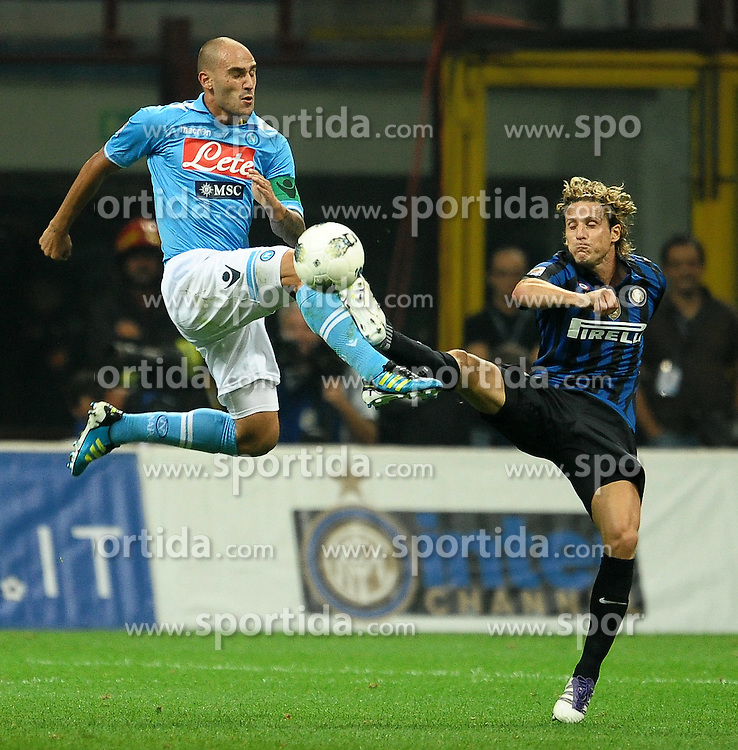 01.10.2011, Giuseppe Meazza Stadion, Mailand, ITA, Serie A, Inter Mailand vs SSC Neapel, im Bild Paolo CANNAVARO Napoli, Diego FORLAN Inter.. // during Serie A football match between Inter Milan and Napoli at Giuseppe Meazza Stadium in Milan, Italy on 1/10/2011. EXPA Pictures © 2011, PhotoCredit: EXPA/ InsideFoto/ Andrea Staccioli +++++ ATTENTION - FOR AUSTRIA/(AUT), SLOVENIA/(SLO), SERBIA/(SRB), CROATIA/(CRO), SWISS/(SUI) and SWEDEN/(SWE) CLIENT ONLY +++++