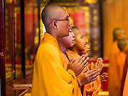 27 JANUARY 2017 - BANGKOK, THAILAND: Mahayana Buddhist monks lead a prayer at Wat Mangkon Kamalawat on Chinese New Year in Bangkok. 2017 is the Year of the Rooster in the Chinese zodiac. This year's Lunar New Year festivities in Bangkok were toned down because many people are still mourning the death Bhumibol Adulyadej, the Late King of Thailand, who died on Oct 13, 2016. Chinese New Year is widely celebrated in Thailand, because ethnic Chinese are about 15% of the Thai population. Wat Mangkon Kamalawat is a Thai-Chinese Buddhist temple.       PHOTO BY JACK KURTZ