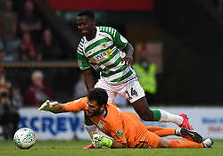 Aston Villa's Goalkeeper Andre Moreira and Yeovil Town's Diallang Jaiyesimi during the Carabao Cup, First Round match at Huish Park, Yeovil.