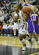 December 22 2010: Iowa guard Kachine Alexander (21) passes the ball during the first half of an NCAA college basketball game at Carver-Hawkeye Arena in Iowa City, Iowa on December 22, 2010. Iowa defeated Northern Iowa 75-64.