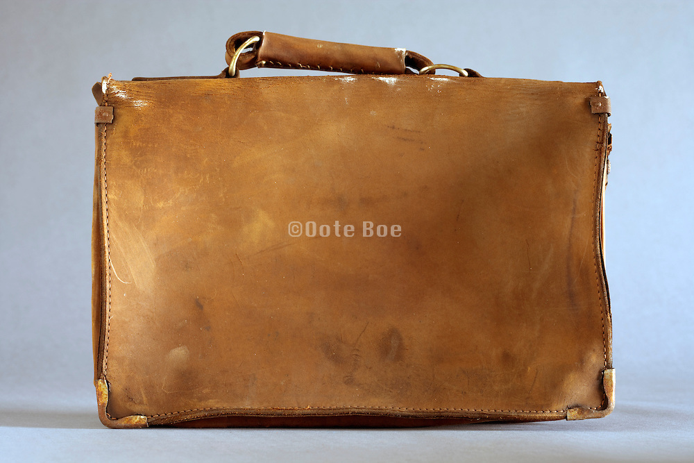back of an old weathered leather briefcase