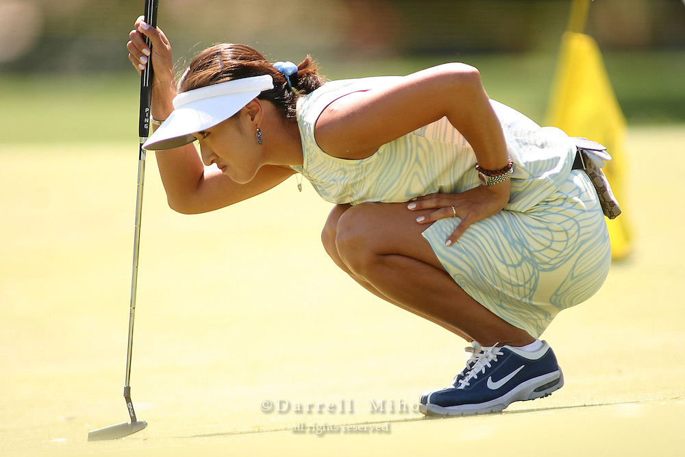 March 28, 2004; Rancho Mirage, CA, USA;  Grace Park checks the slope of the green during the final round of the LPGA Kraft Nabisco golf tournament held at Mission Hills Country Club.  Park won her first major tournament by one stroke over Aree Song with an overall score of 11 under par 277.  She finished the day with a 3 under par 69.<br />Mandatory Credit: Photo by Darrell Miho <br />&copy; Copyright Darrell Miho