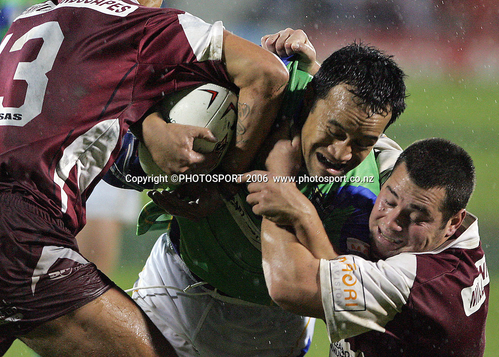Harbour's Hopoate Tuihalangingie is tackled during the Bartercard Cup rugby league match between Waitakere Rangers and Harbour League at Mt Smart Stadium, Auckland, on Saturday 5 August 2006. Photo: Michael Bradley/PHOTOSPORT<br /> <br /> <br /> 050806