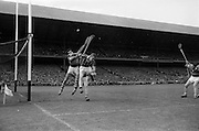 03/09/1967<br /> 09/03/1967<br /> 3 September 1967<br /> All-Ireland Senior Hurling Final: Kilkenny v Tipperary at Croke Park, Dublin.<br /> Tipperary defender, R. Henderson (center) jumps to save the ball.