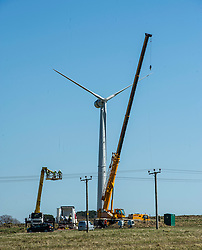 Pictured: Engineers had ideal weather conditions to check the turbine.<br /> <br /> Pomathorn Fam wind turbine was under repair today on the outskirts of Loanstone, near Penicuik Midlothian. The cost to hire the cranes and cherry picker required to reach up to the 16.5 metre turbine blades coming in at around £17,000 per day means that it is not an everyday task.<br /> <br /> Ger Harley | EEm 20 April 2016