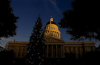 The capitols sits in the late afternoon sunlight before Governor Arnold Schwarzenegger and 9-year-old José Antonio Damian Puga of Santa Maria, lit up the State Capitol Christmas Tree on the west steps of the Capitol, Tuesday Dec. 6, 2005.