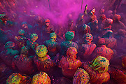 People of Braj sitting and singing chants during a ritual of Braj Holi know as Samaaj where people of Nand Gaon ( Village of Lord Krishna ) and Barsaana ( village of Lord Krishna's beloved, Radha ) sit together and abuse each other by the way of singing songs. Others throw colored powder and water on each other while celebrating the festival of colors, Holi of Braj Region