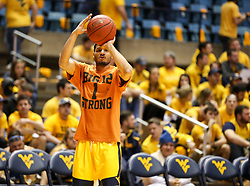 Jan 20, 2018; Morgantown, WV, USA; West Virginia Mountaineers guard James Bolden (3) wears a warm up shirt in honor of Andrew Jones, the Texas point guard who was recently diagnosed with leukemia prior to their game against the Texas Longhorns at WVU Coliseum. Mandatory Credit: Ben Queen-USA TODAY Sports