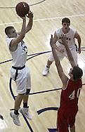 Cedar Rapids Xavier's Calvin Winker (23) puts up a jumper as Ottumwa's Cater Burns (40) tries for the block during their game at Xavier High School in Cedar Rapids on December 10, 2013.