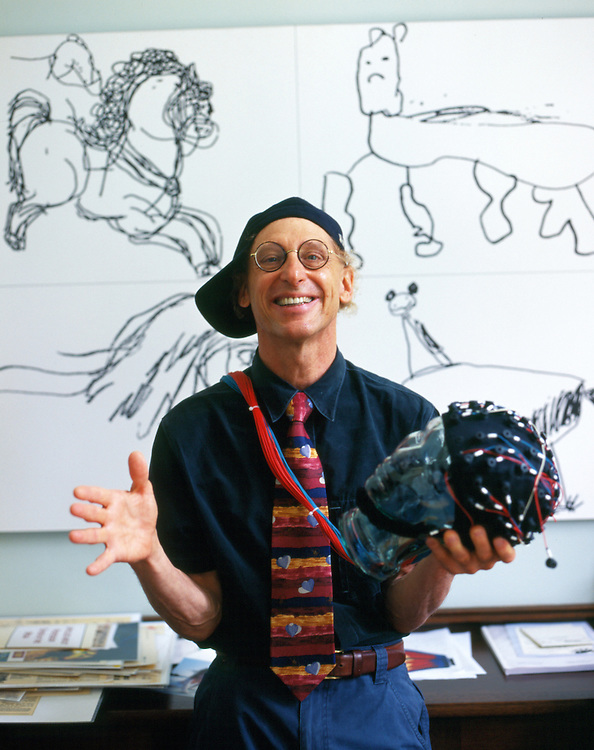 "Professor Alan Snyder of The Centre for the Mind at Sydney University with his ""think cap"". The pictures on the wall were drawn by four year old autistic children..Sydney, March 2003"