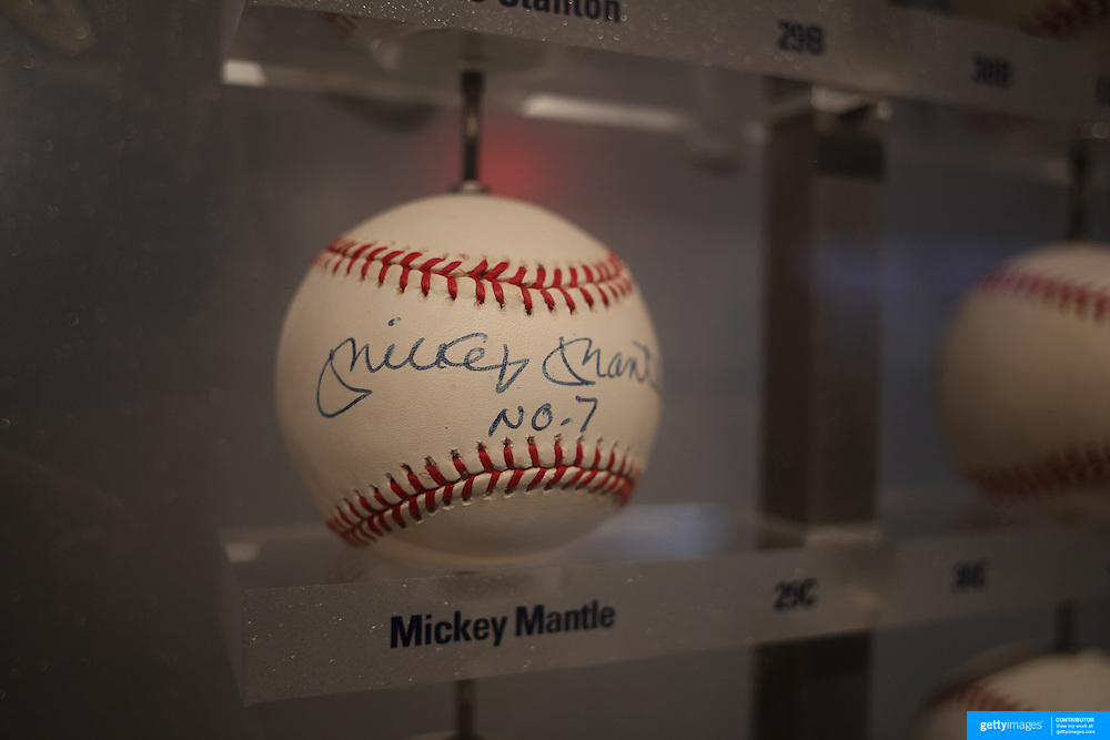 A baseball signed by Mickey Mantle sits along side baseballs signed by Yankees players past and present inside the Yankee Museum at Yankee Stadium, The Bronx, New York.  Photo Tim Clayton