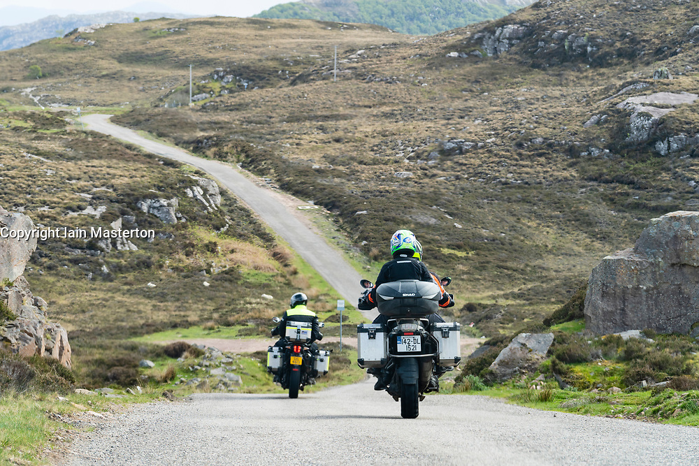 Motorcycles on the North Coast 500 scenic driving route in northern Scotland, UK