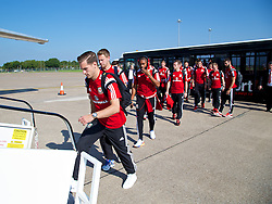 CARDIFF, WALES - Sunday, September 7, 2014: Wales' Aaron Ramsey boards the plane at Cardiff Airport as the squad flies to Andorra ahead of the opening UEFA Euro 2016 qualifying match. (Pic by David Rawcliffe/Propaganda)