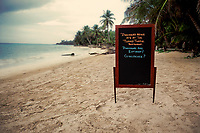 Sign in front of Little Corn Beach & Bungalow on Little Corn Island, Nicaragua. Copyright 2017 Reid McNally.