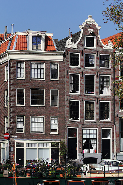 A rather crooked house in traditional style along Prinsengracht, one of the major canals that form a semi-circle in the centre of Amsterdam