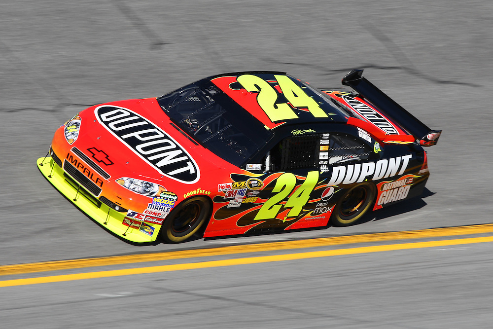Feb 6, 2010; Daytona Beach, FL, USA; NASCAR Sprint Cup Series driver Jeff Gordon (24) exits turn four during qualifying for the Daytona 500 at Daytona International Speedway. Mandatory Credit: Douglas Jones-