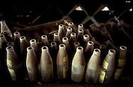 The former capital of Montserrat, Plymouth, which is now covered under a layer of ash, mud and rock from the eruption of the Soufriere Hills volcano over the last 10 years. The area is out of bounds to everyone except scientists. Photo shows empty beer bottles in an abandoned supermarket..Photo©Steve Forrest/Workers Photos
