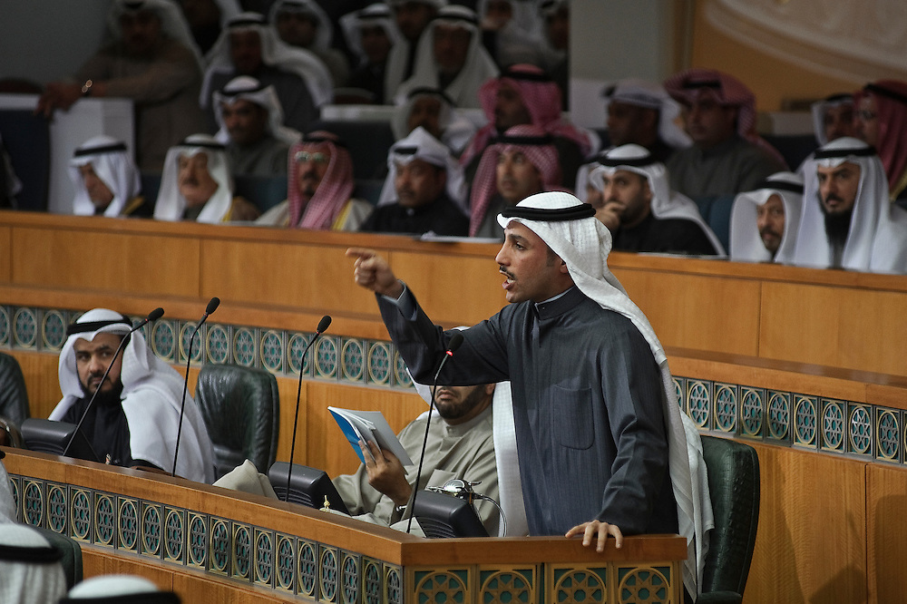 Member of Parliament Marzouq Al-Ghanem gestures during a discussion in parliament following the state opening of the 14th legislative term's first session on Feb. 15, 2012 in Kuwait City. Kuwaitis voted Feb. 2 for a new 50-member National Assembly (parliament).