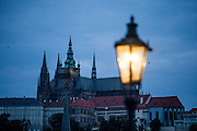 Charles Bridge and the view to Prague Castle during the early morning change from night to day.