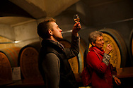 Local tourists sample wine in the tasting room of Denbies Wine Estate on November 27, 2013, in Dorking, United Kingdom. (Warrick Page for The New York Times)