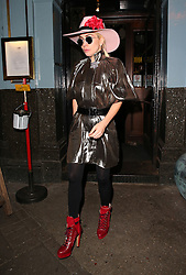Singer Lady Gaga wearing a pink hat, silver matalic trench coat and red boots enjoys a late lunch at The Eagle pub in Old Steet, London, UK. 07/12/2016<br />