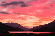 Brightly coloured sunset over Loch Leven on an October evening, near to Kinlochleven in the Scottish Highlands.
