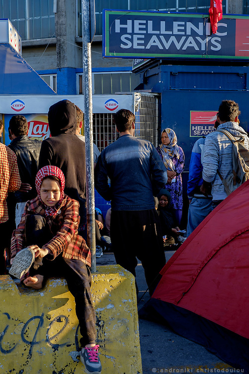 Refugees waiting for the ticket office to open so that they can buy tickets for the ferry to Athens. <br /> The port of Mytilene where many refugees stay while they apply for a permit to stay in Greece or while they are waiting to board the ferry to Athens.